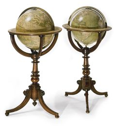 A pair of Victorian twelve-inch terrestrial and celestial globes by Cruchley's on walnut stands Terrestrial Globe dated 1874.