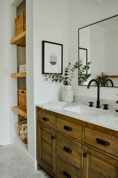 How to Transform a Linen Closet to Open Shelving - House On Longwood Lane bathroom remodel, white bathroom, white subway tile wall, matte black tub filler, white free standi Bathroom Plants, Wood Bathroom, Bathroom Shelves, Small Bathroom, Bathroom Organization, Bathroom Ideas, Master Bathrooms, White Bathrooms, Bathroom With Tile Walls