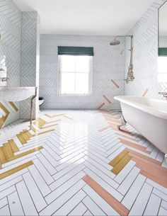bathroom tile ideas - made a mano - Make a boring white bathroom exciting by laying tiles in a herringbone pattern and layering in a touch of color. Bathroom Tiles Images, White Bathroom Tiles, Bathroom Floor Tiles, White Tiles, Bathroom Tile Patterns, Bathroom Flooring Options, Bath Tiles, Shower Floor, Bathroom Wall