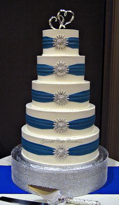 Royal Blue and Silver Reception | ... Buttercream Wedding Cake with Royal Blue Sashes and Silver Brooches