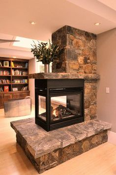 fireplace ideas for master bedroom. Don't care for the book case. 3 Sided Fireplace, Cabin Fireplace, Inglenook Fireplace, Brick Fireplace Makeover, Bedroom Fireplace, Fireplace Remodel, Modern Fireplace, Living Room With Fireplace, Fireplace Design