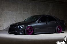 Lexus IS300 in Gray Graphite Pearl on Purple Enkei RPF1 wheels