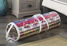 Keep all your wrapping paper in one, protected place with a gift wrap organizer.