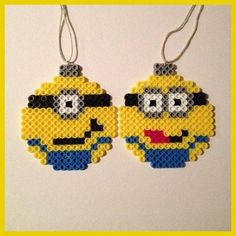 (Loved these as a kid, never thought to make ornaments)! I will now be busy making a million different ornaments! Minions Christmas ball ornaments perler beads by Melty Bead Patterns, Pearler Bead Patterns, Perler Patterns, Beading Patterns, Hama Beads Design, Perler Bead Designs, Diy Perler Beads, Christmas Perler Beads, Beaded Christmas Ornaments