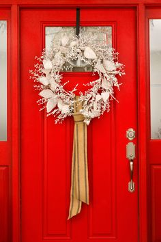 so festive! | Red Door with Silver Wreath