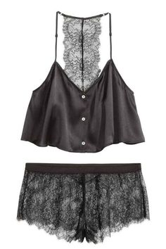 cfaa4682c9 Pyjamas comprising a short satin top made from mulberry silk and lace  shorts. The top has a V-neck