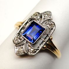 A sweet Art Deco Ring made of 14k gold with diamonds and a synthetic sapphire.