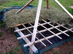 Haystacks - The One Scythe Revolution (POSM Note: stacking hay on floor of pyramid in preparation for storage until needed for animals)