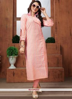 Here is a very pretty readymade kurti in peach color fabricated on khadi cotton beautified with lining prints all over. It is available in all regular sizes Printed Kurti Designs, Kurti Neck Designs, Kurta Designs Women, Kurti Designs Party Wear, Blouse Designs, Fancy Kurti, Embroidered Kurti, Kurti Patterns, Kurti Collection