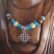 Sharon Bush has weaved her fascination of the ancient world with her love of writing and all things spiritual. Buddhist Symbols, Cycle Of Life, Festival Wear, Blue Cream, Buddhism, Compassion, Fascinator, Jewelry Crafts, Turquoise Necklace
