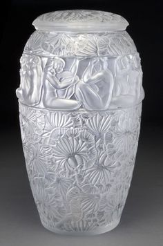 "Monumental Lalique ""Angelique"" clear glass vase with lid, cast and etched to depict leaves with a band of nude female silhouettes. Lid and vase etched, ""Lalique France 185"" with Lalique France sticker. 21.5''H, Circa - 20th C."