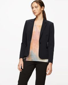 Tailored jacket with single-button closure flawlessly cut from an Italian gabardine stretch-wool blend for a flattering slim tailored finish. Notch lapels, button cuffs, welt pockets and beautiful interior detail with Jigsaw signature spot lining to create a stylish drape. Expertly tailored inside and out, this piece is perfect to pair with other sartorial separates to create a well-tailored suit.