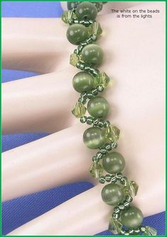 Jewelry is made with small beads. Some are glass or stone. Adult supervision is recommended.    This bracelet is made with Miyuki 11/0 round silver lined olive green glass seed beads along with 4mm olive green Chinese bicone glass crystals, and is accented with 6mm round olive green cats eye glass beads and hooks with a lobster claw clasp.    We make our bracelets with 6 or 8 lb Fireline fishing line and they are double strung for added strength. We also use split rings instead of jump…