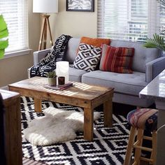 Notice the beige wall with the gray couch.  - need to determine what color couch would work with my gray wall paint & help warm accent colors mingle with black and gray