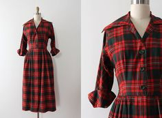 Fantastic plaid wool dress from the late 1940s / early 50s. This dress features a fitted waistline, a green / red plaid, and a button up bodice. There are also pockets in the skirt! Label: Imported Viyella fabric Closure: button up front Fabric: 55% wool 45% cotton Measurements: Best Fits: xsmall  Bust: 36 Waist: 25 Hips: up to 54 Length: 46 Sleeve Length: 16.5 rolled  Condition: nearly excellent vintage condition - there is a minor repair / darning on shoulder line that gets hidden by…