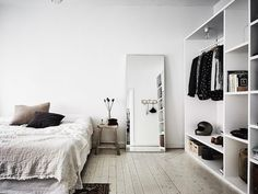 A bedroom in a serene Swedish home with Autumn accents / Anders Bergstedt for Entrance.