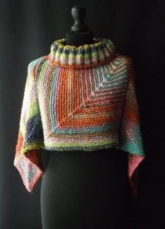 """Ravelry Noro Topper Knitting pattern by Brian Smith Designs - Four squares make this cosy Topper using Noro's """"Obi"""" yarn. It can be worn with the points at the front and back, or to the sides. Knitted Poncho, Knitted Shawls, Knit Shrug, Capelet, Knit Or Crochet, Crochet Shawl, Ravelry Crochet, Single Crochet, Knitting Designs"""