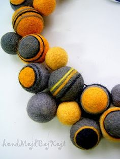 Felted beads--love the color contrast.