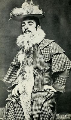Toulouse-Lautrec Wearing Jane Avril's Feathered Hat and Boa (ca. 1892), photo Maurice Guibert.