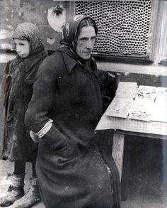 Warsaw, Poland, A peddler in the market in the ghetto. Both pictured did not survive