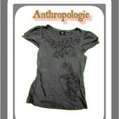 ANTHROPOLGIE -DELETTA TOP ANTHROPOLOGIE -Deletta gray top Double row of ruffled short sleeves Embroidery in black stitching on gray material which flows over to one shoulder Has some stretch. No rips or stains! No trading! Anthropologie Tops
