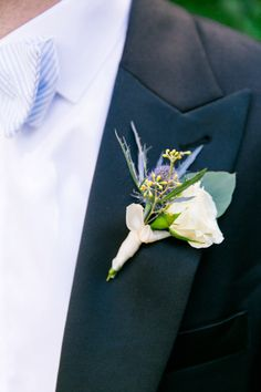 Ivory garden rose boutonniere, dark navy tuxedo + seersucker bowtie | Summer Blue + White Island House Wedding by Charleston wedding photographer Dana Cubbage Weddings