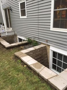 Side by side Marvin Divided Lites Egress Windows in Block Well with step at home in Shorewood, MN Affordable Egress Windows & Basement Waterproofing LLC. 763-267-3891