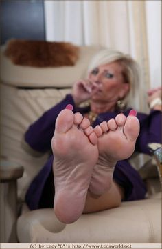 Mature female feet soles