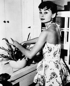 Audrey Hepburnarrangesflowers in her kitchen, 1954 - she was a kind soul!