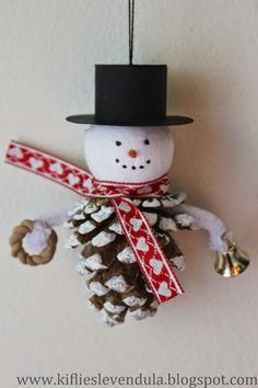 Snowman ornament made with pinecone and styrofoam ball.  She even made the little top hat!