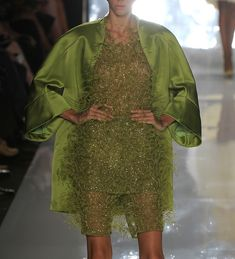 A GREEN SATIN JACKET AND A GREEN LACE DRESS BY CHADO RALP RUCCI SPRING/SUMMER 2013