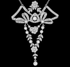 This is an elegant platinum pendant with 18k white gold chain necklace from the Edwardian era