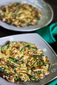 Crispy Korean Kimchi Seafood Pancakes - Known as Haemul Pajeon, this is commonly found on the streets of South Korea. A quick, crispy and crunchy snack just waiting to be flipped onto your plate at home. | wandercooks.com
