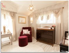 Gray and plum baby nursery with dark wood