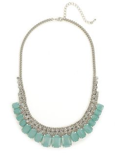 This statement necklace is equal parts elegance and extravagance — just check out those gobstopper gems in beautiful mint hues. That crystal-embellished chain, meanwhile, adds shot of street-chic edge.