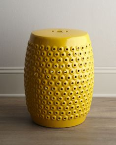 I want to build a small collection of ceramic garden stools for the new house.  Love the color, texture and price of this one. Yellow Pierced Ceramic Stool - Neiman Marcus