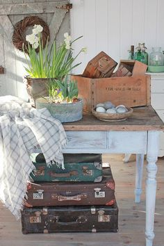 Vibeke design.  Me to a tee. Suitcases, crates, antiques, bulbs though don't bring mine inside, and throws.
