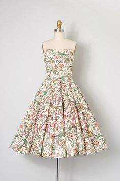 vintage 1950s strapless cotton dress. beautiful floral print in an autumnal color palette, sweetheart bust, boning on each side of bodice, full skirt, sequin design on skirt front, hip pockets(!) and back center metal zipper with a hook and eye up top  L A B E L n/a  M E A S U R E M E N T S bust 32 waist 25 hips open bust to hem length 39.5  will best fit an extra-small.       |      |     |     |     |   make sure to measure   |     |     |     |      C O N D I T I O N excellent. ______...