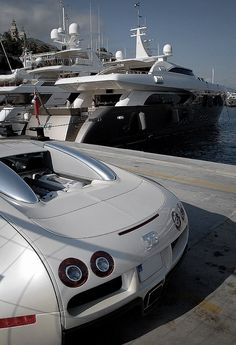 White Bugatti Veyron in front of the yachts in Monaco Port
