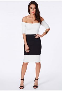 For a touch of monochrome fantasy in your wardrobe this season, this bodycon beauty is ideal. The gorgeous colourblock design is eyecatching and the bardot shoulder detail adds a classic touch to your outfit. Style it up with gold accessori...