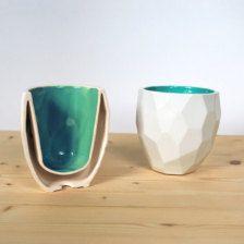 Double walled, slip cast mug.