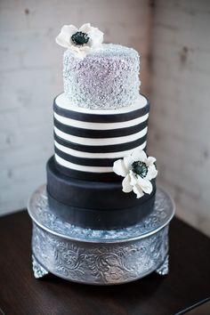 black white and silver wedding cake on gorgeous silver pedastal