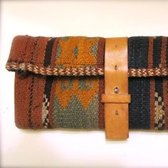A simple clutch for this season! Made from a square foot of carpet and an old belt. Click for tutorial.