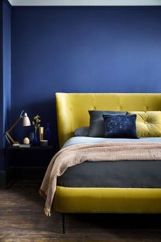 The Beauty of Blue In Your Home & How To Use It | Yellow is blue's complementary colour on the colour wheel as is orange. Utilising them together can create an invigorating and revitalising colourscheme. Or try using orange for a more medieterrean vibe. #blueandyellowinteriors #bluedecor #interiors #blueinteriors #bedroomideas #bedroom #interiordesign #interiorinspo #homedecor