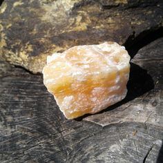 Beautiful Raw Uncut Orange Calcite Crystal~  Size ~ 42mms × 36mms   Weight ~ 69 grams   You will receive the actual crystal in this picture $2.50  All pictures of our Crystals are taken in natural sunlight  Link to our Etsy Shop is on our Pinterest Page