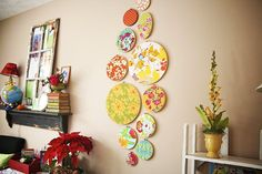 embroidery hoops with fav fabric...wall art...can change it on the cheap...hall art since the boys will knock it down!  Yes please