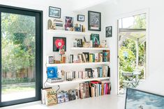 Built-in bookshelves create a dedicated reading corner that looks out onto the backyard and patio. Swoon much? #refinery29 http://www.refinery29.com/small-space-makeover#slide-17