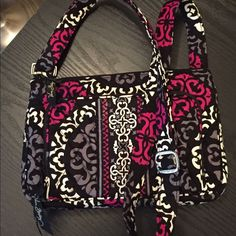 Vera Bradley cross body purse with built in wallet Cute cross body, has front zip wallet section, full size pocket on the back side, middle zip section exactly the right size to hold iPad mini. Great condition, never used! Vera Bradley Bags Crossbody Bags