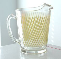 Clear Pitcher with Yellow Stripes.... this looks like a Hazel Atlas piece of glass...