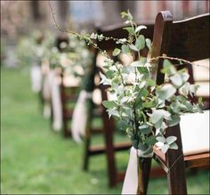 Ceremony aisle bundles with greenery.